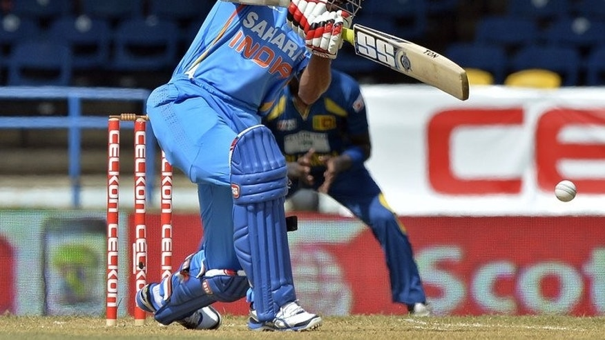 Indian batsman Shikhar Dhawan plays a shot during the Tri-Nation series match against Sri Lanka at the Queen's Park Oval stadium in Port of Spain on July 9, 2013. Sri Lankan captain Angelo Mathews won the toss and has put India into bat first in the sixth and final preliminary match of the Tri-Nation Series against India at Queen's Park Oval.