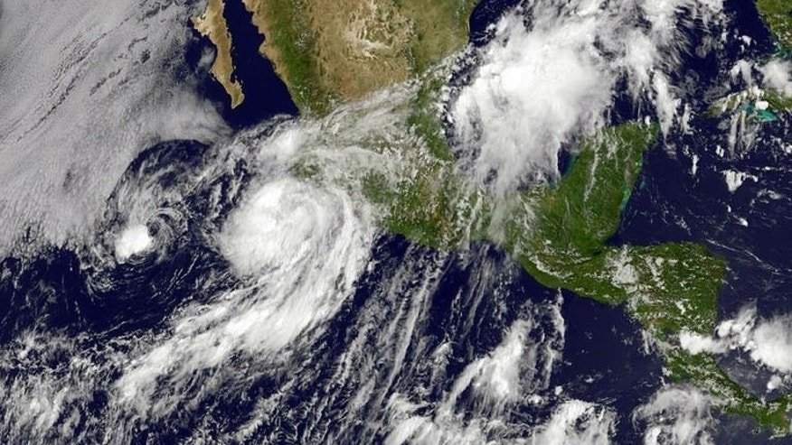 An image obtained from NOAA shows then-Hurricane Erick moving up the western coast of Mexico on July 6, 2013. At least two people died and two more remained missing after the tropical storm grazed Mexico's Pacific coast before weakening into a tropical depression, authorities said Tuesday.