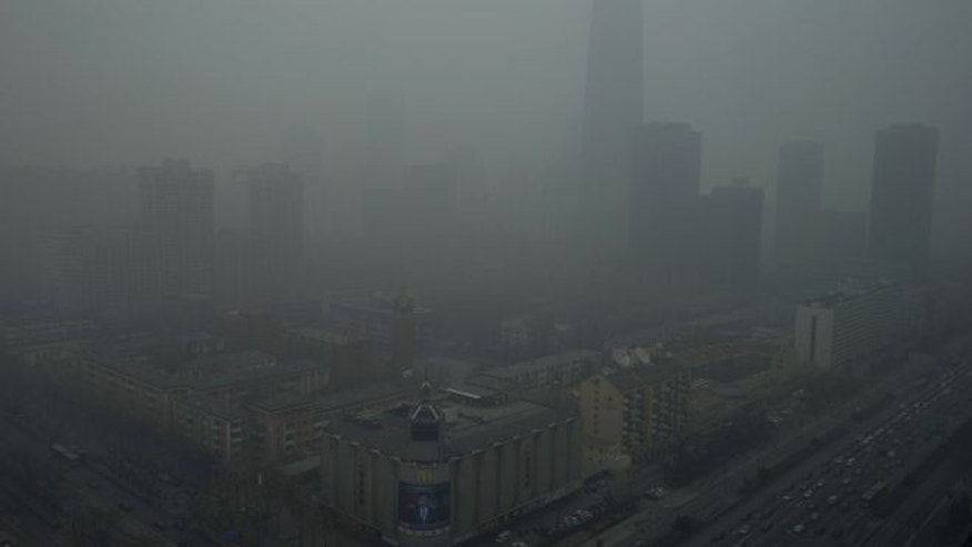 Jan. 13, 2013: Skyscrapers are obscure by heavy haze in Beijing.