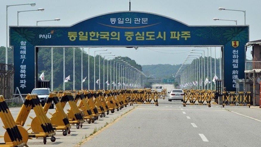 Cars drive past barricades on the road linking North Korea's Kaesong Industrial Complex at a military check point in Paju near the demilitarized zone dividing the two Koreas on June 6, 2013. Seoul and Pyongyang were to start fresh talks on reopening a joint industrial complex Wednesday as a group of South Korean factory owners visit the mothballed site.