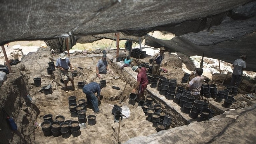 Volunteers from Hebrew University work during an excavation at the northern Israeli archeological site of ancient Tel Hazor, on July 9 2013.