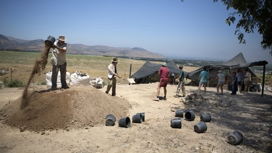 Volunteers of the Hebrew University work during an excavation at the northern Israeli archeological site of the ancient Tel Hazor on July 9 2013.