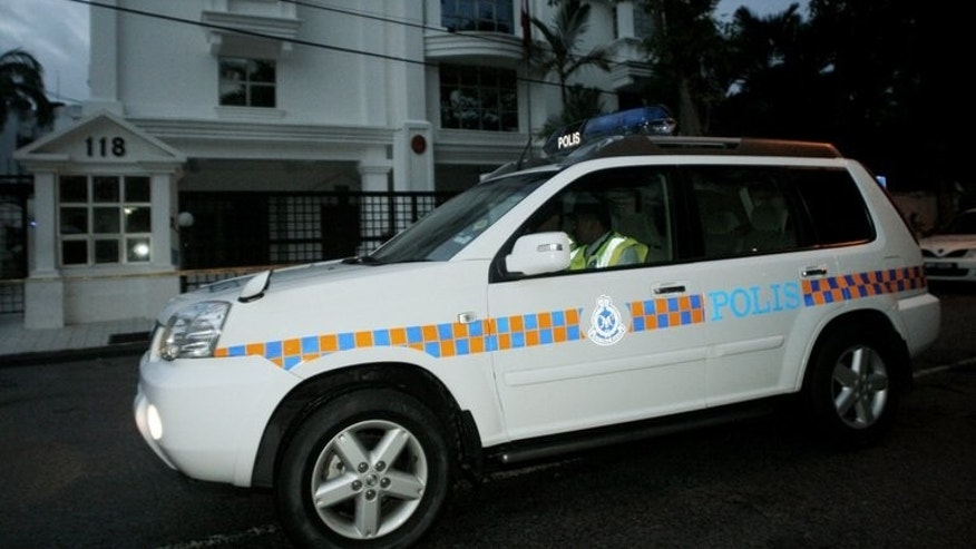 A Malaysian police car on patrol in Kuala Lumpur, on June 29, 2008. The alleged gang-rape of a female official by three handball players has rocked Malaysia's sports community, with officials demanding tough punishment for the perpetrators.