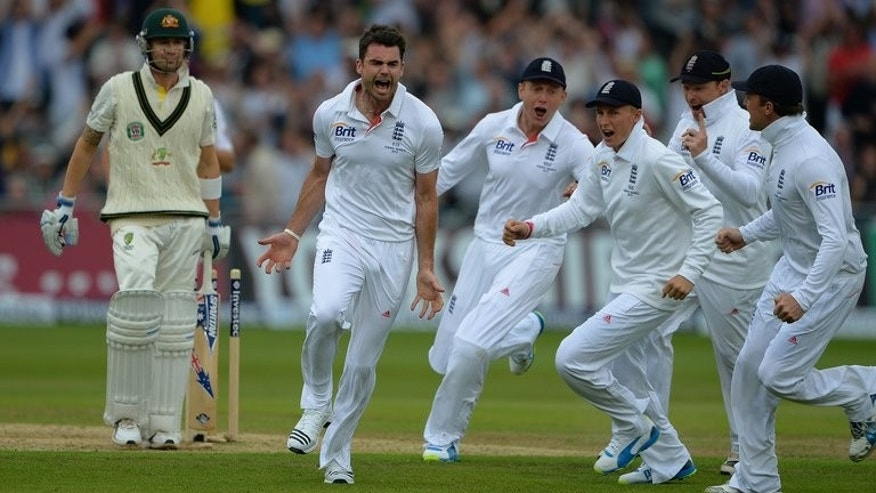England's James Anderson celebrates after bowling out Australia's Michael Clarke (L) in the first Ashes Test on July 10, 2013. Australian media bemoaned another brittle top-order batting display in undermining the good work from the bowlers on a topsy-turvy opening day of the series.