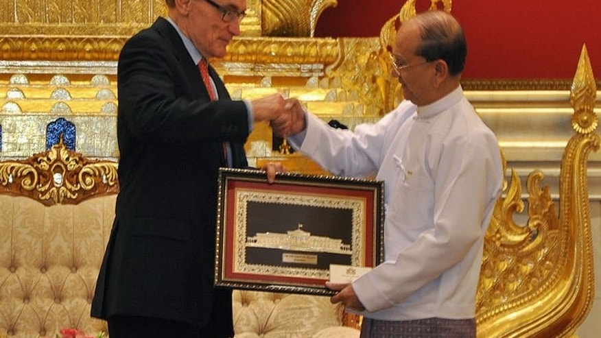 This handout picture from Myanmar News Agency (MNA) shows Myanmar President Thein Sein (right) shaking hands with Australian Foreign Minister Bob Carr during their meeting in Naypyidaw, on July 10, 2013. Carr has met Myanmar's reformist leaders on a visit aimed at boosting relations with the former junta-ruled nation in reward for sweeping political changes.