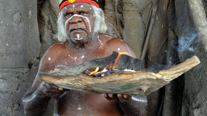 An Aboriginal elder performs a 'Welcome to Country' smoking ceremony on Goat Island, in Sydney Harbour on April 18, 2010. Aborigines are the most disadvantaged Australians, with indigenous children twice as likely to die before their fifth birthday as other children and Aboriginal men estimated to die 11.5 years earlier than other males.