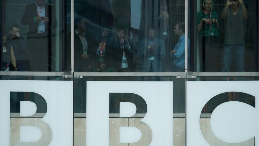 "Members of the BBC staff are seen in the of Broadcasting House in central London on June 7, 2013. BBC Trust chairman Chris Patten said that the size of payoffs given to senior staff at the corporation was a cause of ""shock and dismay"" as he was hauled before MPs for questioning."