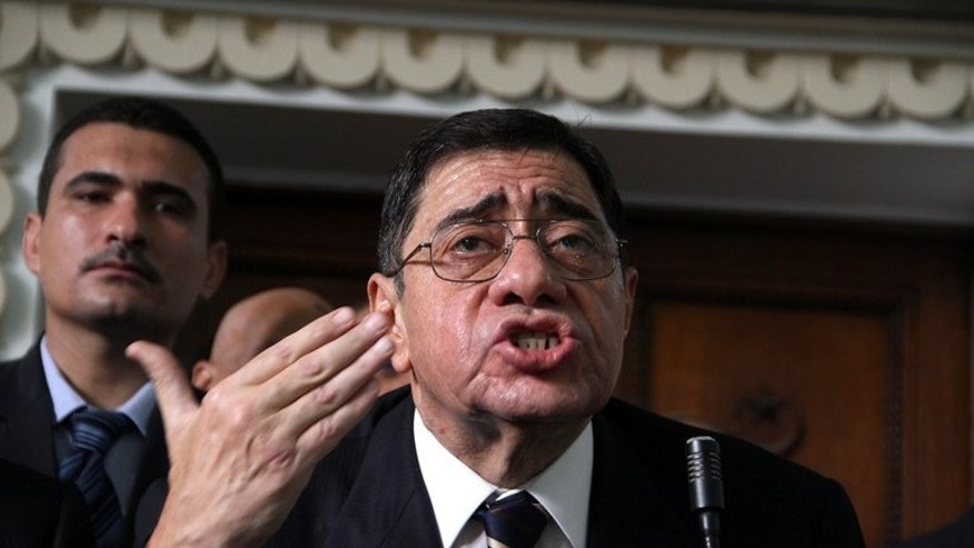 Former prosecutor Abdel Meguid Mahmud addresses judges in his office at the high court in Cairo last October. Egypt on Wednesday appointed a new public prosecutor after the resignation of his controversial predecessor, a judicial source said.