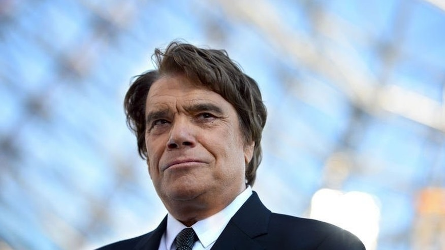 French tycoon Bernard Tapie before the start of a league match in Marseille, on May 26, 2013. French corruption investigators have seized the assets of Tapie, suspected of having committed fraud as part of an organised gang, judicial sources have said.