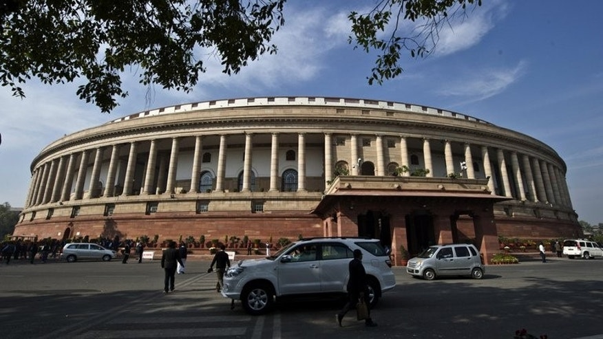 Indian lawmakers arrive at the parliament building in New Delhi, on December 5, 2012. India's top court has ruled that lawmakers should be thrown out of office if they are convicted of a serious crime, a judgement hailed as a major step towards cleaning up the political system.