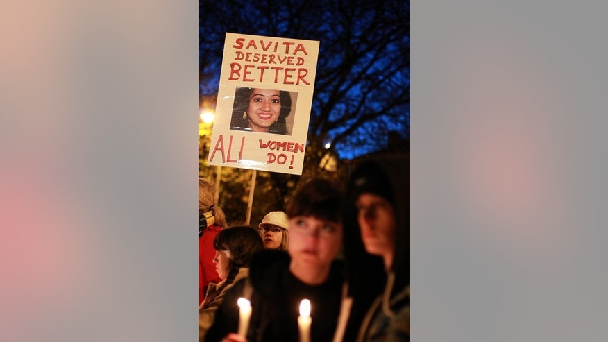 Protesters hold placards in memory of Savita Halappanavar as they demand a change to the abortion laws during a march to the Irish Parliament in Dublin, on November 17, 2012. Irish lawmakers are set to introduce abortion in limited cases where the mother's life is at risk, when controversial new laws go to a final vote.