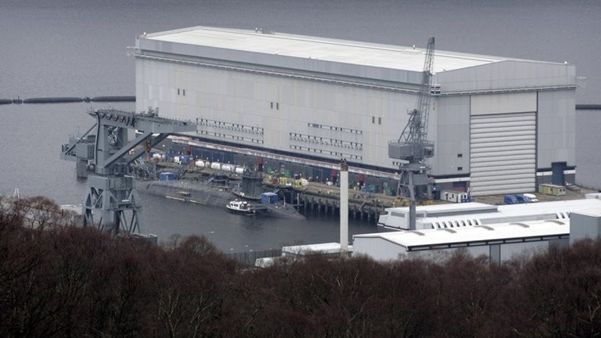 A trident submarine is shown at the Faslane naval base, Scotland, in 2007. The Scottish National Party has promised to get rid of all nuclear weapons if it secures a 'yes' vote in the independence referendum in September 2014. London is therefore considering designating as sovereign United Kingdom territory the Faslane base on Gare Loch in Argyll and Bute.
