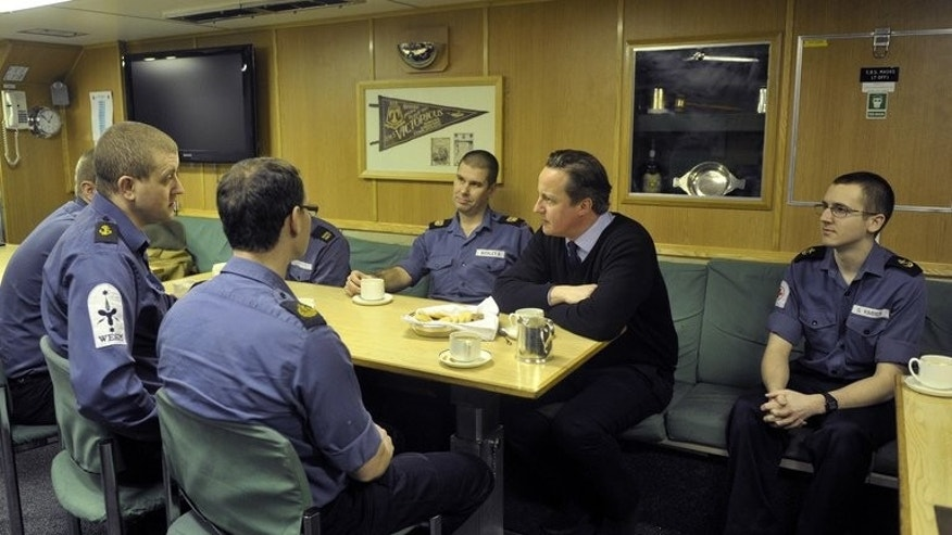 Prime Minister David Cameron speaks with Navy personnel during a visit to the Trident Nuclear Submarine, HMS Victorious, on April 4, 2013. Britain holds a long-standing belief in continuous at-sea deterrence, which requires the running of at least one Vanguard submarine armed with 16 Trident nuclear missiles at any given time.