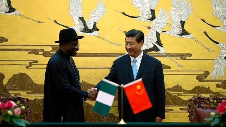 Chinese President Xi Jinping (R) shakes hands with Nigerian President Goodluck Jonathan after the two country's ministers signed several agreements during a signing ceremony at the Great Hall of the People in Beijing on July 10, 2013. Jonathan met Xi in Beijing on Wednesday on a visit focused on boosting trade between Asia's powerhouse economy and Africa's biggest oil producer.