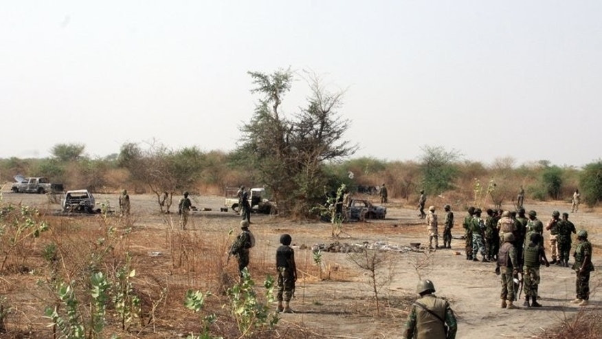 A picture released on May 25, 2013 by the Nigerian military shows members of the Nigerian Defence team inspecting an alleged Boko Haram base in Maduri. A Nigerian minister tasked with talking to Boko Haram claimed Wednesday that he was in ceasefire negotiations with the Islamist insurgents, but doubts persisted that a peace pact could be secured.