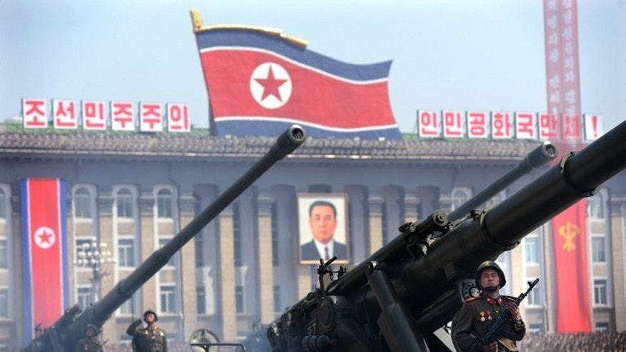 North Korean soldiers salute during a military parade to mark 100 years since the birth of the country's founder Kim Il-Sung in Pyongyang on April 15, 2012. North Korea said Wednesday it was ready to hold international talks in a bid to calm regional tensions, blaming Washington for stoking strife through military exercises with South Korea.