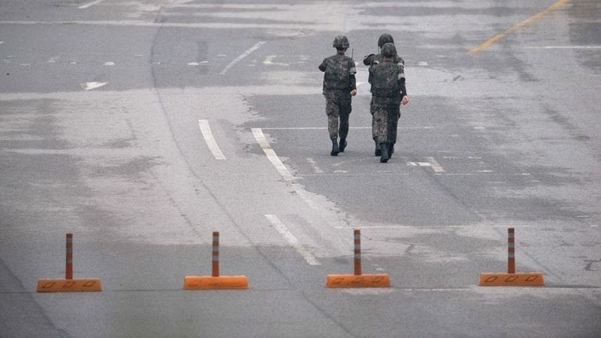 South Korean soldiers walk to take their positions at a South Korean checkpoint in Paju on July 10, 2013. North Korea said Wednesday it was ready to hold international talks in a bid to calm regional tensions, blaming Washington for stoking strife through military exercises with South Korea.