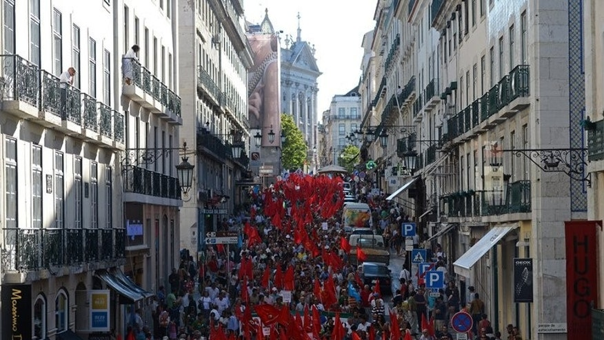 People attend a demonstration called by the Communist Party in downtown Lisbon on July 3, 2013.