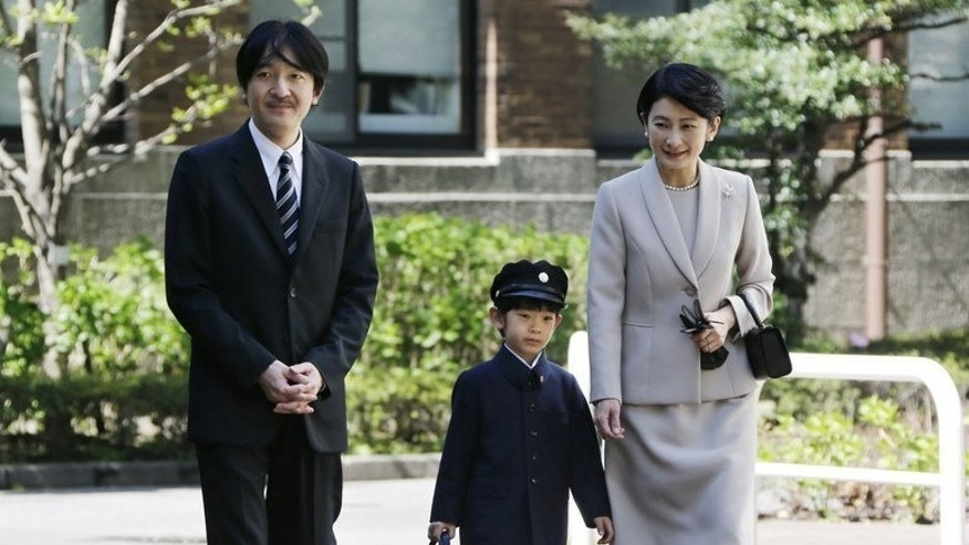 This picture taken on April 7, 2013 shows Japanese Prince Hisahito accompanied by his parents Prince Akishino and Princess Kiko as they arrive at the Ochanomizu kindergarten for his entrance ceremony in Tokyo. As Britain gets royal baby fever and readies to welcome a future monarch, the young boy who carries the destiny of Japan's ancient imperial family lives a life much less examined.