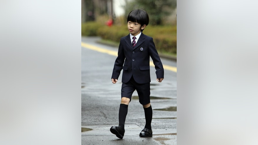 Japan's Prince Hisahito arrives at the Ochanomizu kindergarten for his graduation ceremony in Tokyo, on March 14, 2013. As Britain gets royal baby fever and readies to welcome a future monarch, the young boy who carries the destiny of Japan's ancient imperial family lives a life much less examined