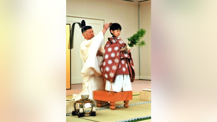 This handout photo taken on October 28, 2011 and released by the Imperial Household Agency on November 3, 2011 shows Japan's Prince Hisahito, wearing traditional ceremonial attire standing on an ancient boardgame at the Akasaka palace in Tokyo. As Britain gets royal baby fever, the young boy who carries the destiny of Japan's ancient imperial family lives a life much less examined.