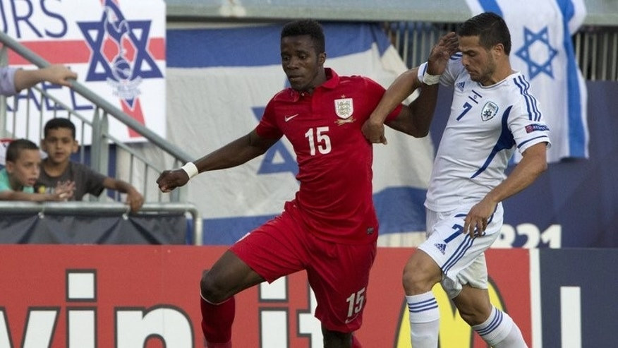Wilfried Zaha (left) plays for England Under-21s against England in Jerusalem on June 11. David Moyes says new signing Zaha will join Manchester United's squad for their pre-season tour of east Asia and Australia.