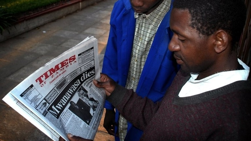 Zambians read a newspaper on the streets of Lusaka on August 20, 2008. Zambia charged two journalists with sedition late Wednesday in what their lawyer said appeared to be a witch hunt for writers of an online publication critical of the government.