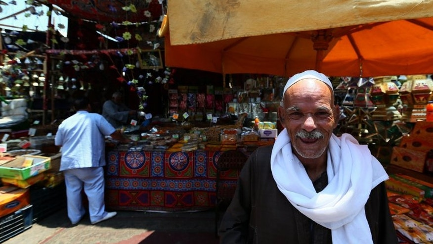 An elderly Egyptian man stands in front of a shop selling traditional Ramadan lanterns in the working-class Saida Zeinab district in Cairo on July 11, 2013, the second day of the Muslim holy fasting month. The people of Egypt are marking Ramadan amid soaring tensions following last week's ouster by the military of Islamist president Mohamed Morsi.