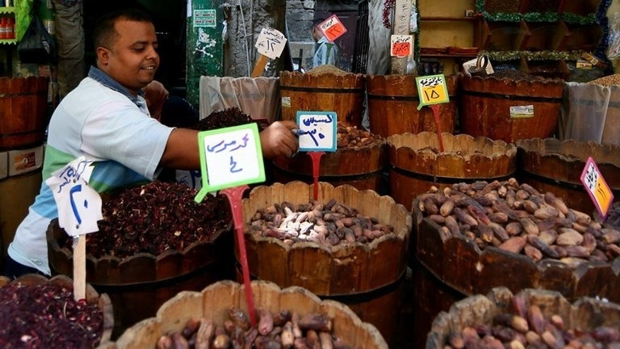 An Egyptian vendor adjusts a price tag for dates at his shop in the working-class Saida Zeinab district in Cairo on the second day of the holy month of Ramadan July 11, 2013.