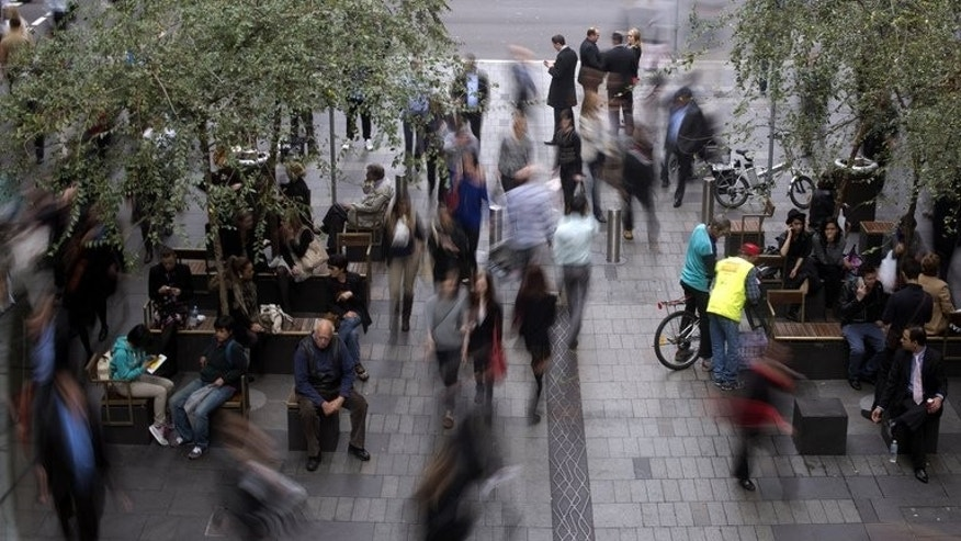People through the central business district of Sydney on June 5, 2013. Australia's jobless rate jumped to 5.7 percent in June, its highest level in almost four years, as the mining-driven economy begins a tough diversification drive to other sources of growth.
