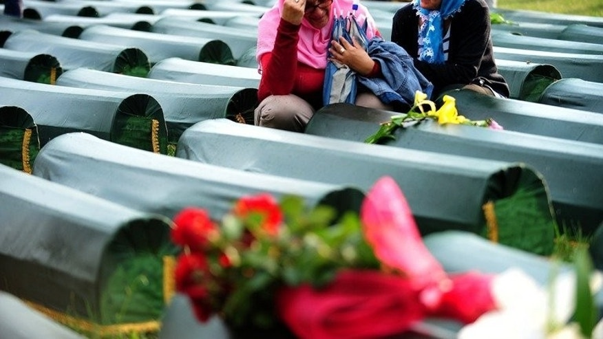 Bosnian Muslim women, survivors of the 1995 Srebrenica massacre, mourn a relative, at the memorial cemetery in Potocari near Srebrenica, on July 10, 2013. Bosnia will bury 409 victims of the Srebrenica massacre, including a newborn baby, on Thursday, the 18th anniversary of Europe's worst post-war atrocity in which Bosnian Serb forces slaughtered some 8,000 Muslims.