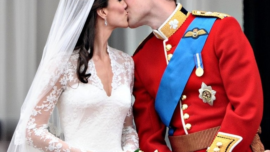 Britain's Prince William kisses his wife Catherine, Duchess of Cambridge, on the balcony of Buckingham Palace, after their wedding on April 29, 2011. Kate Middleton was the middle-class girl who made becoming a princess look easy -- but bringing up a royal baby will bring fresh challenges for Britain's glamorous future queen.