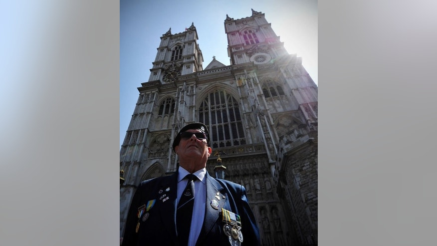 Former British soldier Ernie Dyson poses for a photograph in front of Westminster Abbey in central London, on July 11, 2013. Nearly 300 elderly veterans have marched through London as Britain marked the 60th anniversary of the Korean War armistice.
