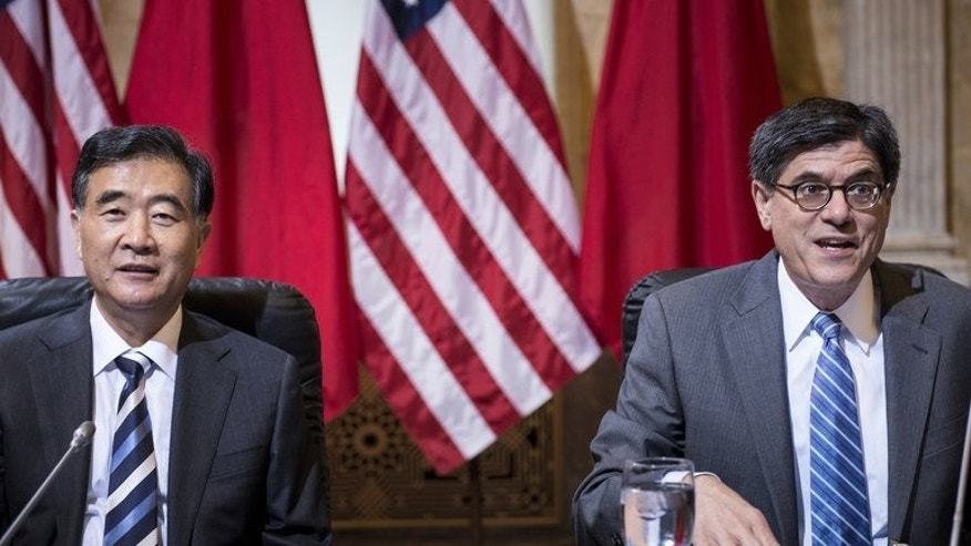 Chinese Vice Premier Wang Yang (left) and US Treasury Secretary Jack Lew wait for the start of a meeting at the US Department of the Treasury in Washington, on July 11, 2013. Wang sparked contempt online after he compared the Sino-US relationship to a marriage -- although not a homosexual one.