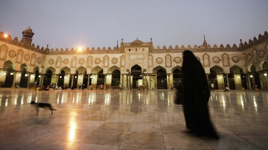 A woman walks outside the Al-Ahzar mosque in Cairo on July 10, 2013. Egypt's new leadership was seeking to push forward with forming a new government on Thursday as police sought to arrest the leader of the Islamist movement defiantly backing ousted president Mohamed Morsi.