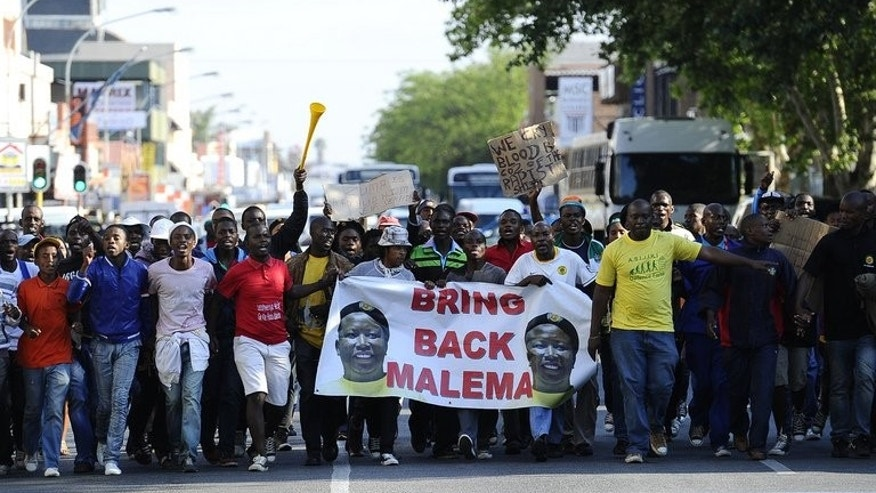 Supporters of Julius Malema demonstrate in Polokwane last September. While not explicitly launching a political party, Malema has staked out a claim to lead the millions of black South Africans whose lives have not improved much since the end of white minority rule two decades ago.