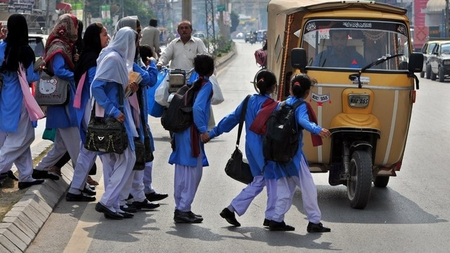 Pakistani school girls cross a street in Rawalpindi on October 19, 2012. When the Pakistani Taliban shot Malala Yousafzai in the head, their message to the world was simple: girls have no right to an education and their dreams of a better future should be crushed. Now more girls than ever in Pakistan's northwestern Swat valley, are in school