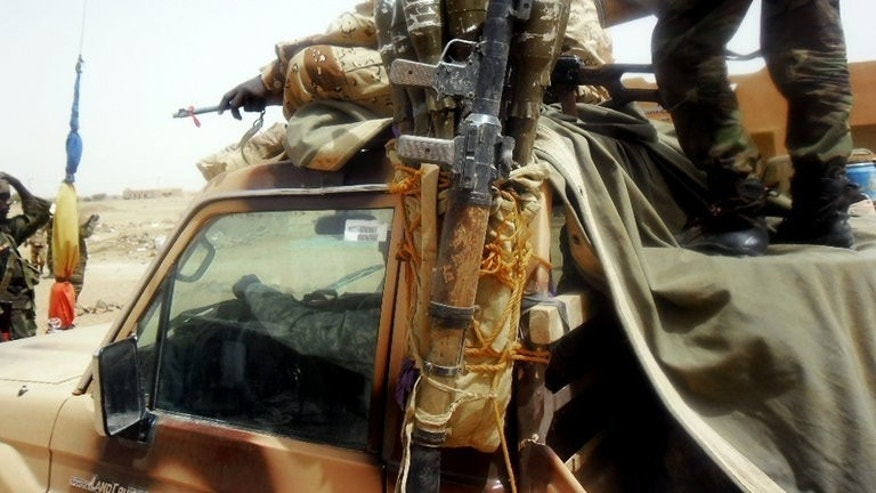 Chadian soldiers patrol in Kidal on April 16. The governor of the flashpoint Malian town of Kidal returned to his job on Thursday after more than a yearlong absence, ahead of crucial nationwide elections later this month.