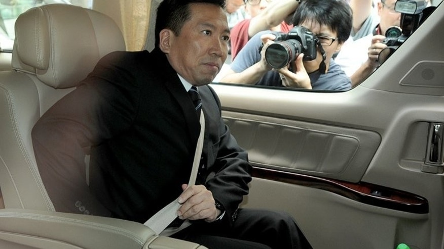 Feng shui master Tony Chan leaves a Hong Kong court in a car on May 14, 2012. He has filed an appeal against his 12-year jail term for forging the will of late billionaire Nina Wang in a bid to steal her fortune, reports said.