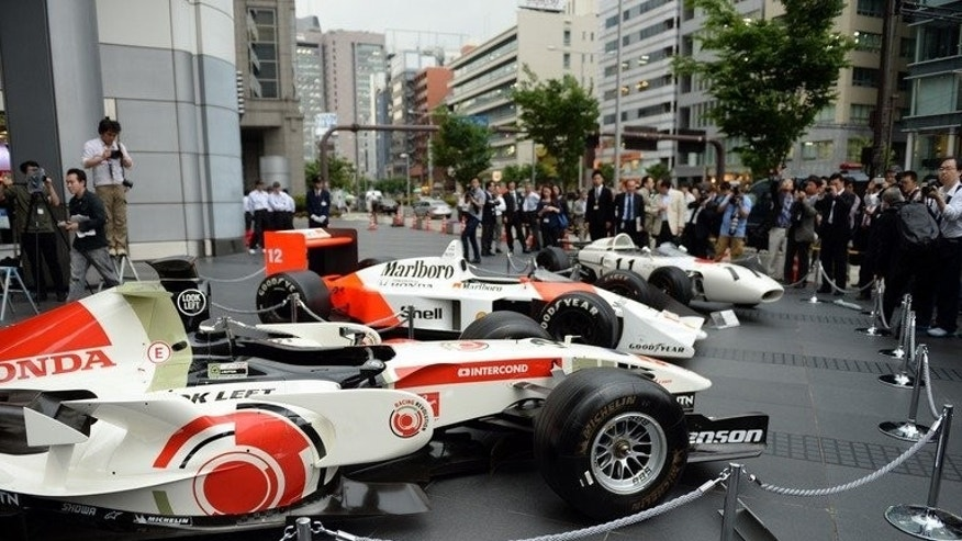 Three generations of Honda Formula One cars on display in Tokyo on May 16, 2013. The Japanese automaker said it will build a European racing operations base in Britain ahead of its return to the sport in 2015.