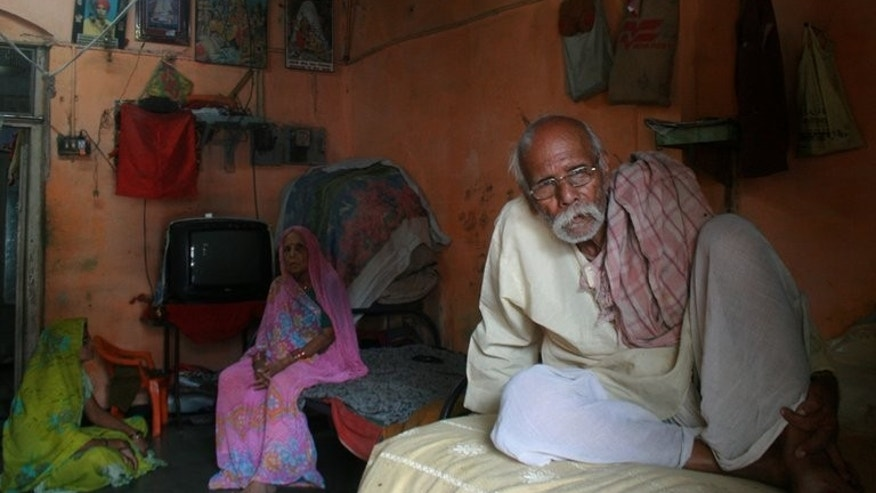 Indian heart patient Niranjan Lal Pathak (right) with his wife Bhankali Pathak at his home in Indore on September 23, 2012. A petition filed by Pathak's family in India's Supreme Court alleges he was enrolled without consent in a trial of the drug Atopaxar, developed by Japan-based pharmaceutical company Eisai and supposed to treat anxiety disorders.