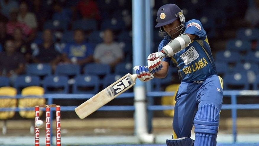 Sri Lankan cricketer Mahela Jayawardene plays a shot during the final match of the Tri-Nation series between India and Sri Lanka at the Queen's Park Oval stadium in Port of Spain on July 11, 2013.