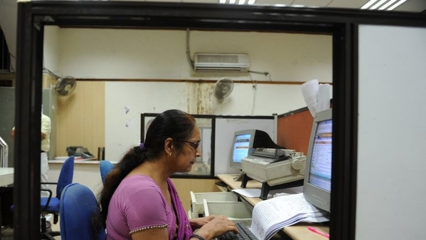 In this picture taken on July 10, 2013 a worker types a telegram at the Central Telegraph Office in New Delhi. With the service made redundant by a technological revolution, the final message will be sent next Monday, July 15.