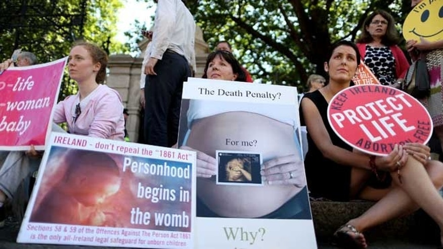 July 10, 2013: Anti-abortion campaigners wait outside the Irish Parliament at Leinster House, Dublin ahead of a parliamentary vote on abortion. Irish politicians will vote Wednesday to pass divisive laws to legislate for the first time for abortion in limited circumstances.
