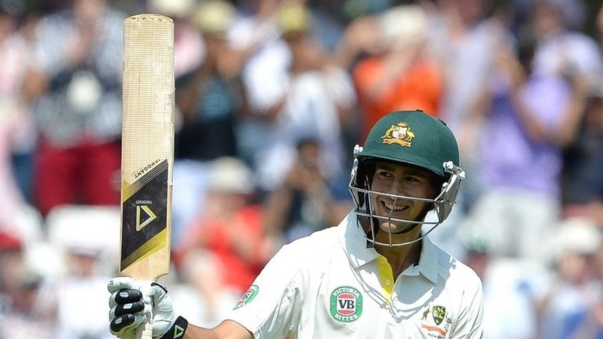 Australia's Ashton Agar celebrates his half-century during the first Ashes Test on July 11, 2013. Agar was acclaimed a national sporting hero by Australia's press after the youngster's record-breaking 98 on debut that has turned the opening Test against England.