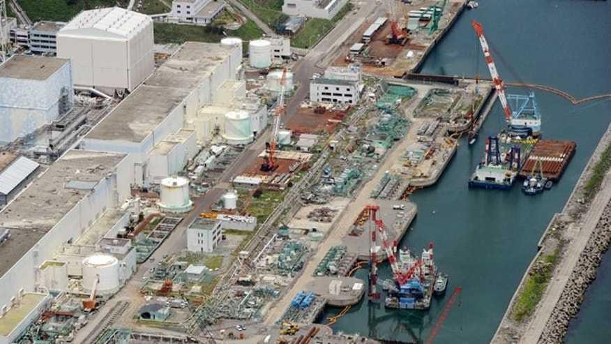 July 9, 2013: This aerial photo taken on shows reactor buildings Unit 2, left, and Unit 1 at Fukushima Dai-ichi nuclear power plant in Okuama, Fukushima Prefecture, northern Japan.