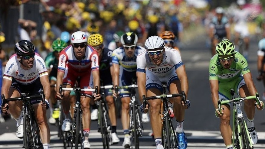 Germany's Marcel Kittel (2R) crosses the finish line ahead of Britain's Mark Cavendish (L) and Slovakia's Peter Sagan (R) in the best sprinter's green jersey at the end of the 218 km 12th stage of the Tour de France between Foug??res and Tours, northwestern France on July 11, 2013. Kittel claimed his third stage win of the 100th Tour de France when he beat BCavendish to victory.