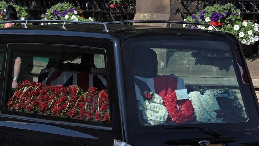 A hearse carries the coffin of British Fusilier Lee Rigby on July 11, 2013. Rigby, 25, was hacked to death in broad daylight near his barracks in Woolwich, southeast London, on May 22.