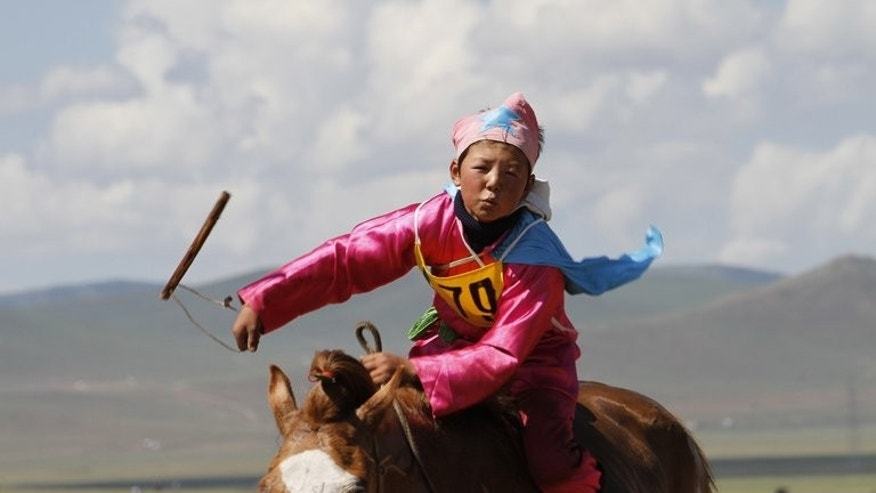 A Mongolian youngster takes part in a horse race at the annual Naadam festival in Ulan Bator on July 10, 2012. As Mongolia's biggest national festival, Naadam, begins on Thursday, controversy is mounting over the way unprotected young riders are risking injury and even death.
