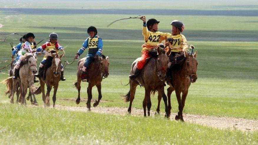 "A group of Mongolian children during a horse race at the annual Naadam festival in Ulan Bator on July 11, 2012. Horseracing is one of the ""three manly sports"" -- along with wrestling and archery -- that make up the Naadam celebrations."